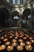 Santa Maria Della Salute Prints - A Tray Of Lighted Candles In The Chuch Print by Todd Gipstein