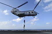 Rotorcraft Photo Prints - A Trio Of Marines Fast Rope Print by Stocktrek Images