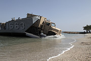 Beachhead Posters - A Truck Offloads From A Landing Craft Poster by Stocktrek Images