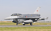 Airfield Prints - A Turkish-built F-16 At The Izmir Air Print by Giovanni Colla