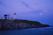 Maine Lighthouses Photo Posters - A Twilight Moon Over The Historic Poster by Stephen St. John