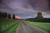 Dirt Roads Photos - A Twilight View Down A Dirt Road by Bill Hatcher