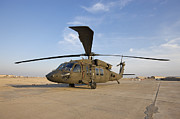 Airfield Prints - A Uh-60 Black Hawk Helicopter At Camp Print by Terry Moore