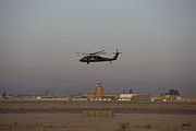 Helicopter Art - A Uh-60 Blackhawk Helicopter Flies by Terry Moore