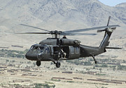 Uh-60 Black Hawk Prints - A Uh-60 Blackhawk Helicopter Print by Stocktrek Images