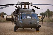 Uh-60 Prints - A Uh-60l Black Hawk With Twin M240g Print by Terry Moore