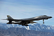 Airplane Photos - A U.s. Air Force B-1b Lancer Departs by Stocktrek Images