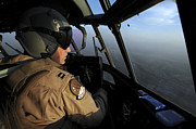 Cockpit Photo Prints - A U.s. Air Force C-130j Hercules Pilot Print by Stocktrek Images