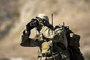 Rangefinder Photos - A U.s. Air Force Combat Controller Uses by Stocktrek Images