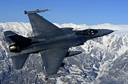 Jets Photos - A U.s. Air Force F-16 Fighting Falcon by Stocktrek Images