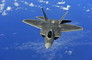 Jetfighter Posters - A U.s. Air Force F-22 Raptor In Flight Poster by Stocktrek Images
