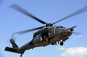 Us Open Framed Prints - A U.s. Air Force Hh-60 Pavehawk Comes Framed Print by Stocktrek Images