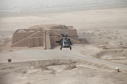 A Us Army Black Hawk Helicopter Hovers Print by Everett