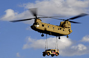 Hmmwv Framed Prints - A U.s. Army Ch-47 Chinook Helicopter Framed Print by Stocktrek Images