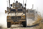 Dirt Roads Photo Metal Prints - A U.s. Army M-atv Leads A Convoy Metal Print by Stocktrek Images