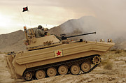 Up-armored Framed Prints - A U.s. Army Soldier Trains On An M113 Framed Print by Stocktrek Images