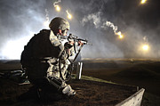 Kneeling Prints - A U.s. Army Soldier Watches His Firing Print by Stocktrek Images