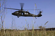 Uh-60 Black Hawk Prints - A U.s. Army Uh-60 Black Hawk Helicopter Print by Stocktrek Images