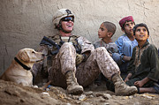 A U.s. Marine Jokes With Afghan Print by Stocktrek Images