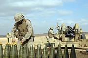 A U.s. Marine Prepares Howitzer Rounds Print by Stocktrek Images