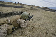 Live Fire Posters - A U.s. Marine Provides Suppressive Fire Poster by Stocktrek Images