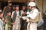 Civilians Framed Prints - A U.s. Marine Talks With Afghans Framed Print by Everett