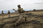 Grenades Prints - A U.s. Marine Throws An M-67 Training Print by Stocktrek Images