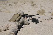 Firearms Metal Prints - A U.s. Marine Zeros His M107 Sniper Metal Print by Stocktrek Images