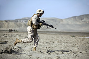 Assault Rifles Photos - A U.s. Marines Runs Across The Beach by Stocktrek Images