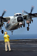 Carrier Prints - A U.s. Navy Officer Observes A C-2a Print by Stocktrek Images