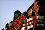 Oppression Photos - A Veiled Bedouin Woman Peers by Thomas J. Abercrombie