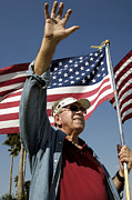 Patriots Prints - A Veteran Waves To Members Of Macdill Print by Stocktrek Images