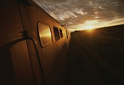 Republic Of South Africa Prints - A View Down The Length Of A Train Print by Tino Soriano