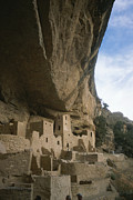 Rocky Cliff Posters - A View Of Ancient Cliff Dwellings Poster by Taylor S. Kennedy