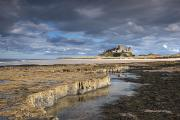 Dark Clouds Photos - A View Of Bamburgh Castle Bamburgh by John Short