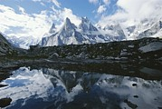 Snow Scenes Art - A View Of The Fathi And Other Peaks by Jimmy Chin