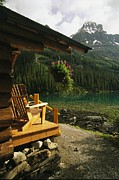 Log Cabins Prints - A View Of The Rocky Mountains From Lake Print by Michael Melford