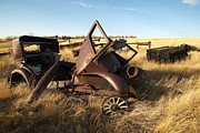 Urban Scenes Photos - A Vintage Car Rusts In A Prairie by Pete Ryan