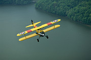 Bi Planes Photos - A Vintage Stearman 43 Biplane Flies by Stephen Alvarez