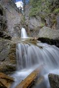 Canadian Prairies Prints - A Waterfall In Kananaskis Print by Philippe Widling