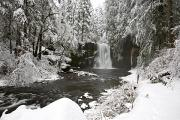 Snow-covered Landscape Photo Prints - A Waterfall In To A River In Winter Print by Craig Tuttle