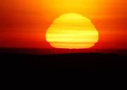Sun Rise Prints - A Wavering Sunrise Print by Jeff  Swan