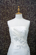 Dressmaker Posters - A Wedding Dress On A Mannequin. A White Poster by Marlene Ford