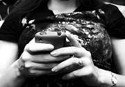 Texting Photo Prints - A Woman And Her Phone Print by Ricky Barnard