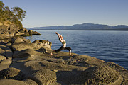 Hornby Island Photos - A Woman Does Yoga At Sunset by Taylor S. Kennedy