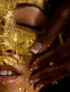 Human Hands Prints - A Woman Receiving A Gold Facial Print by Randy Olson