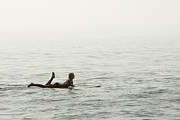 A Woman Rests On Her Surfboard Waiting Print by Tim Davis