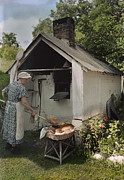 Pennsylvania Dutch Framed Prints - A Woman Takes Bread From An Outdoor Framed Print by J. Baylor Roberts