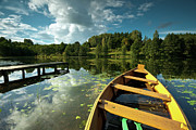 Tree Leaf On Water Photo Prints - A Wooden Boat On A Lake In Suwalki Lake District Print by Slawek Staszczuk