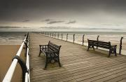 Dark Skies Posters - A Wooden Pier With Benches Looking Out Poster by John Short